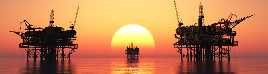 Offshore oil rigs with setting sun